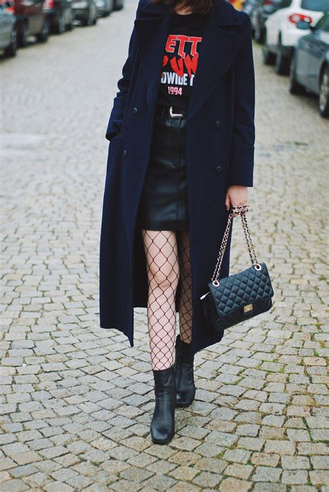 Leather skirt & long navy coat: How to stay warm while