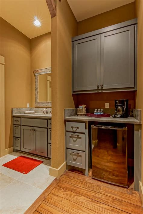 Country Wet Bar and Sink With Gray Cabinets and Mustard