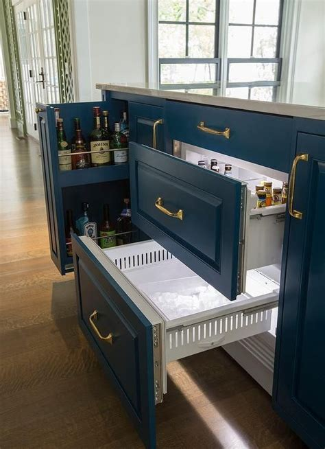 This blue center island features a beverage drawer for